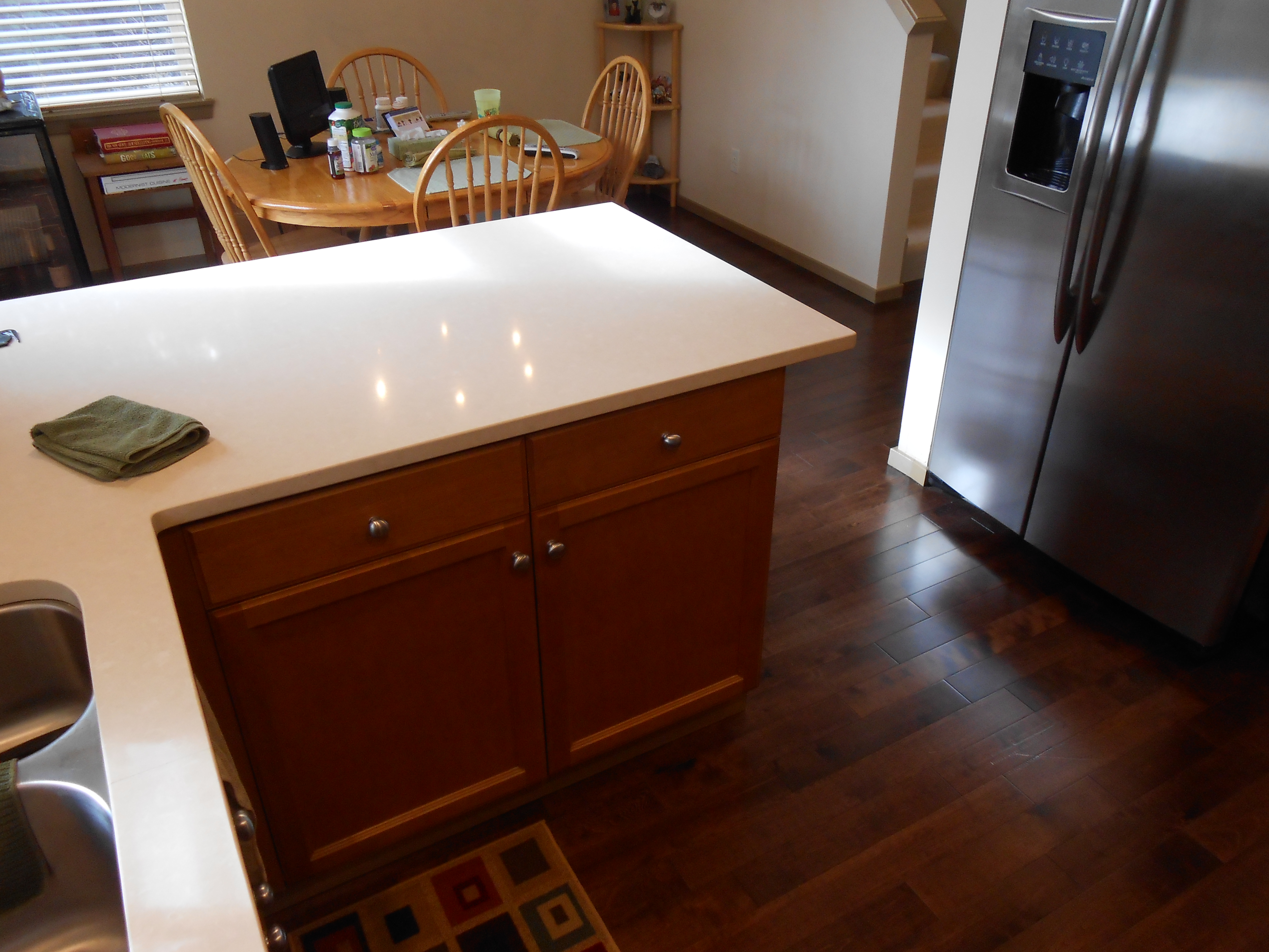 quartz slab countertop and pre-stained hardwood flooring