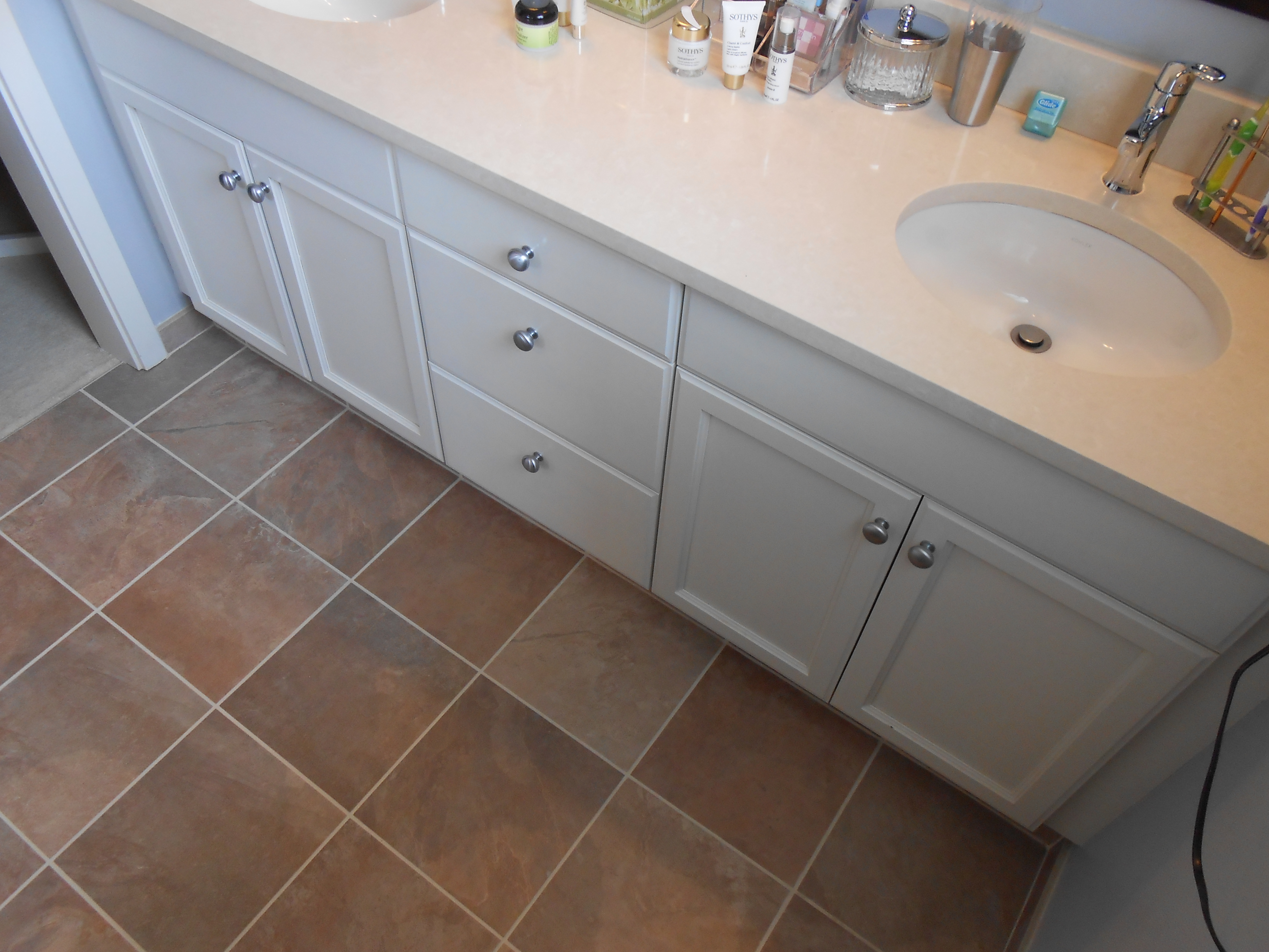 quartz slab countertop and heated tile floor in master bath